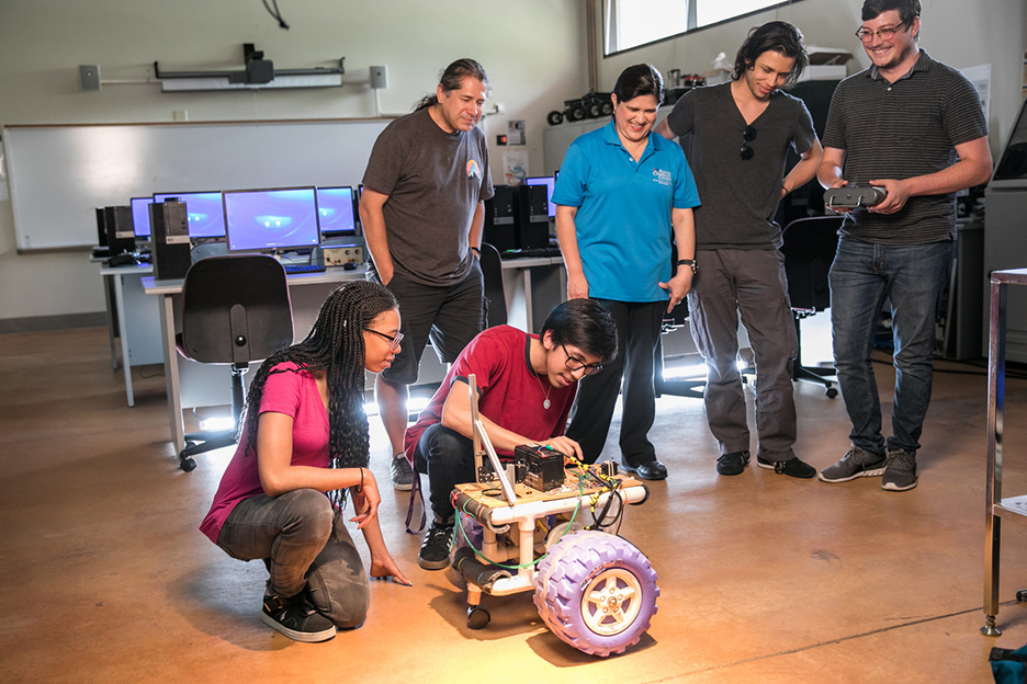 Students using robotics equipment
